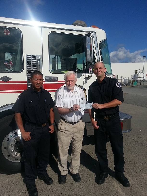 Mervin and Ben present a $2000 cheque to Henry Neufeld from Delta Meals on Wheels