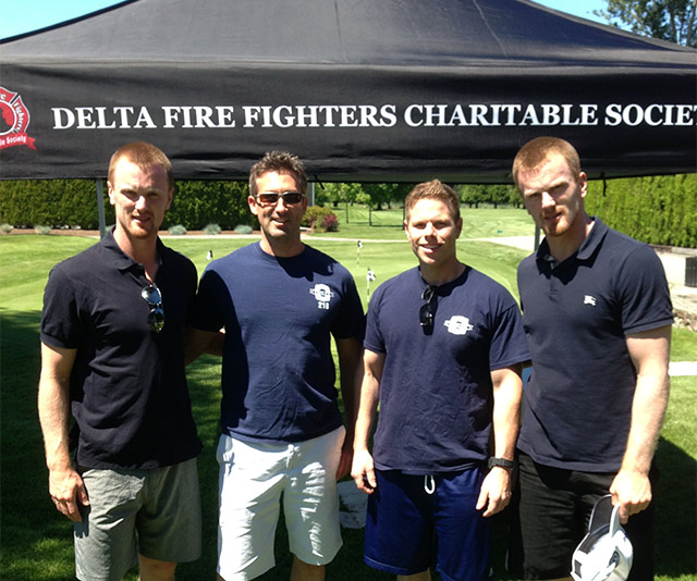 Henrik and Daniel pop by to chat with Delta Firefighters Charitable Society members.